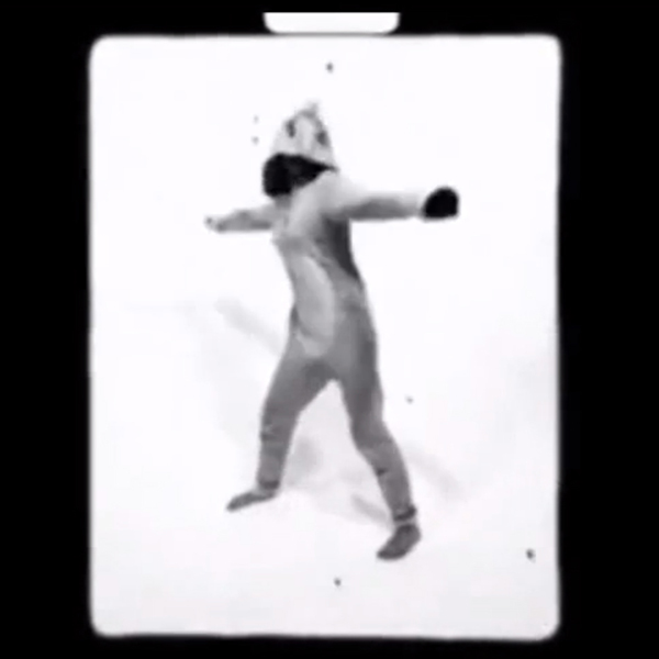 Video still of Miley Cyrus twerking in a frog suit