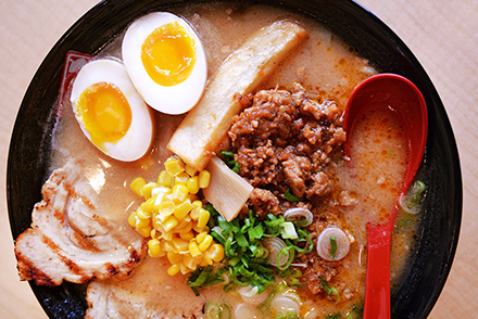 The Hokkaido-style kome ramen, with its rice-and-soybean miso base, produces the deepest, most full-bodied broth on the menu.