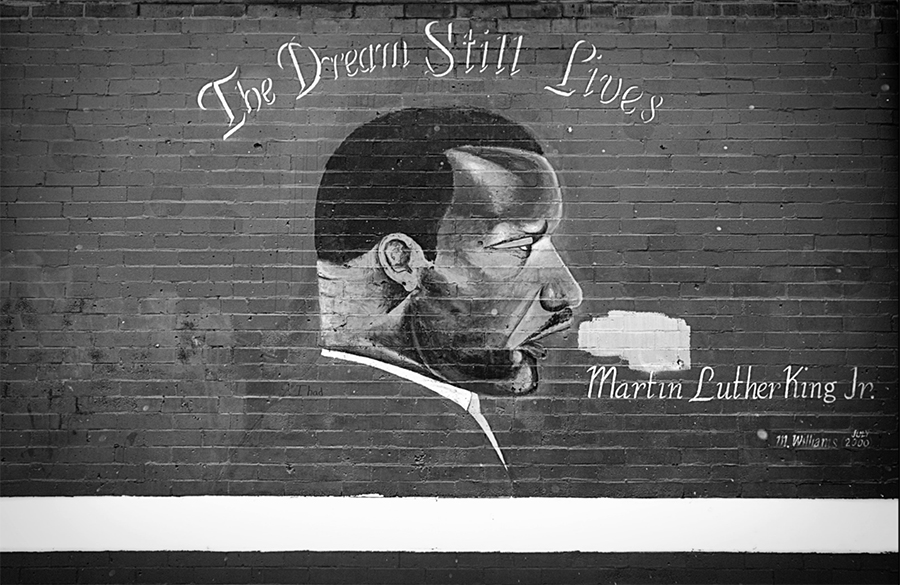 A 2000 mural of Martin Luther King Jr. remains on the north exterior wall of Kohn Elementary School,  April 18, 2013.