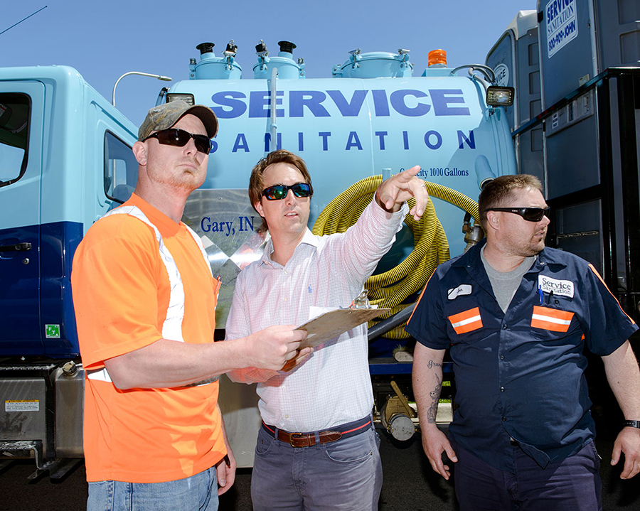 Service Sanitation senior account manager Keith Kay (center) with colleagues Jeffery Matthews and Jon Mosley
