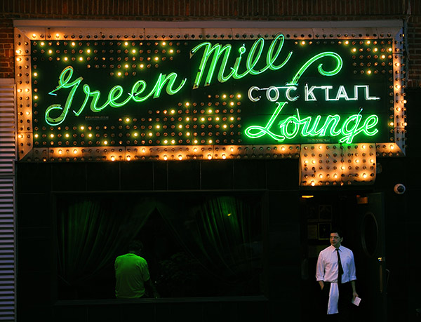 Bartender Jason Cole and the Green Mill's iconic sign