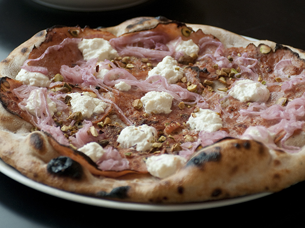 Nellcôte uses house-milled flour  for pizza dough.