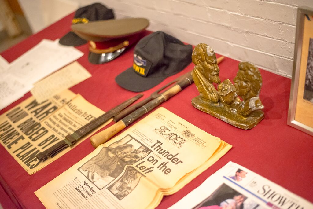 Items from Peery's life—including a veteran's cap and Soviet paraphernalia—on display at his memorial.
