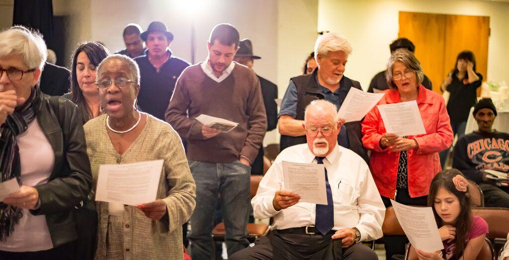 Attendees sing at Peery's memorial service.