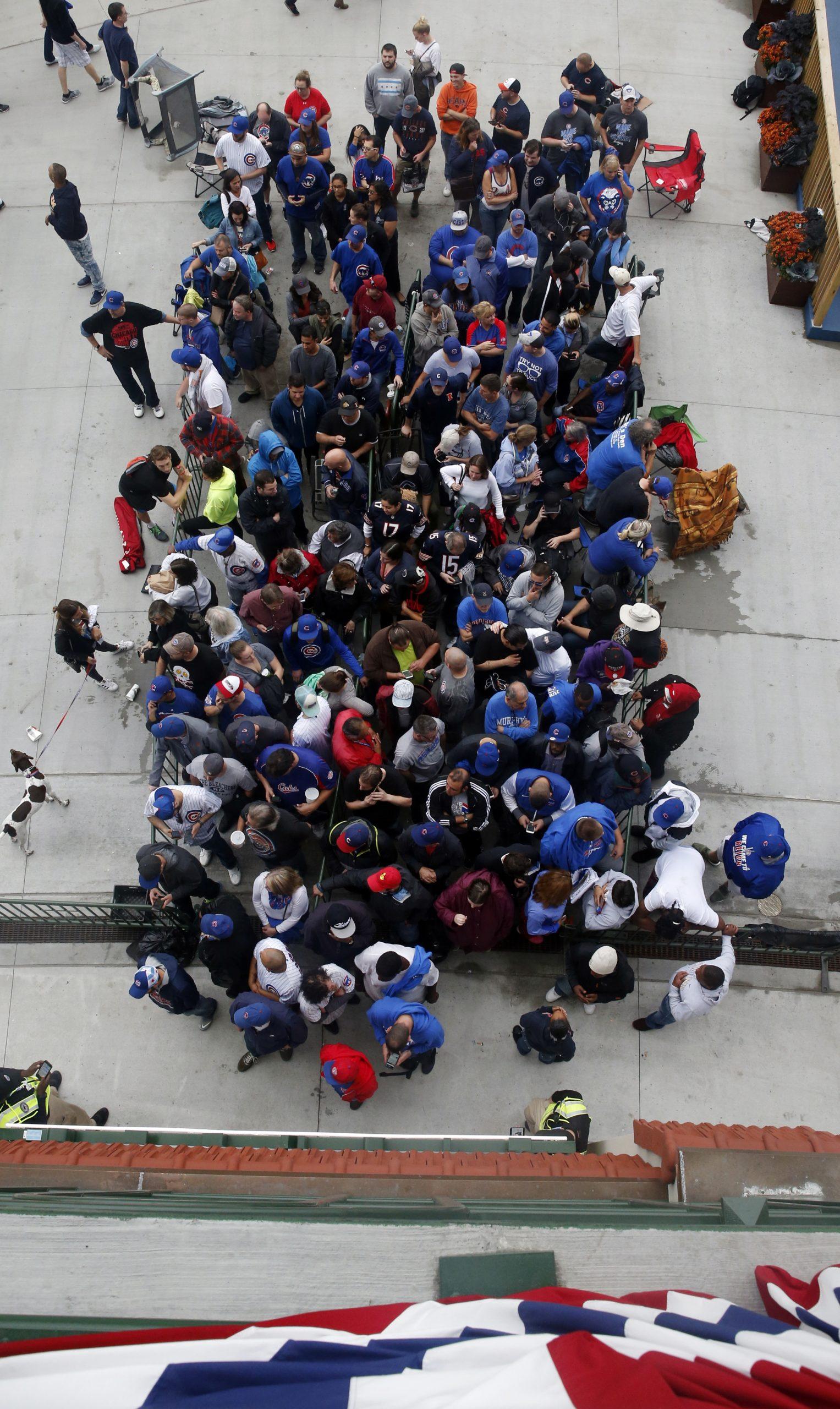 Fans wait to enter Wrigley Field on Sunday.