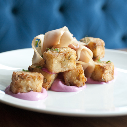 Pickle tots draped with chicken bresoala