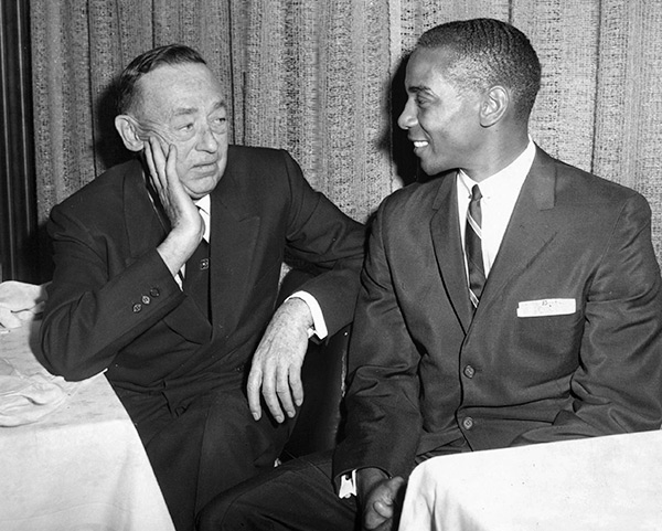 Cubs owner P.K. Wrigley and Ernie Banks, the team's first black player, chat at the team's annual luncheon in 1962.