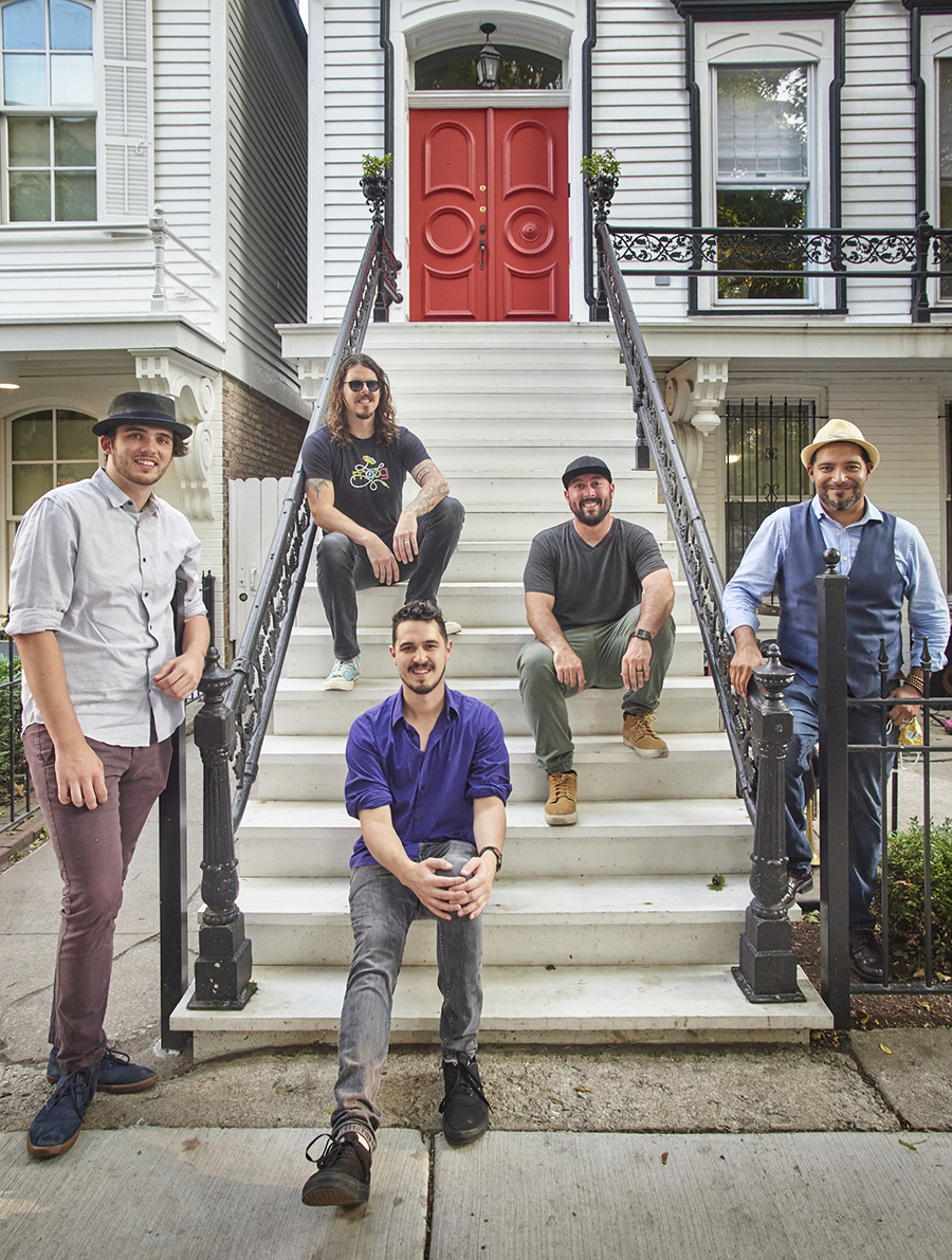 The lineup of the Red Door Band shifts constantly, but on September 5 it was Danny Bauer (purple shirt) and Jack Macklin (far left), the two core members, plus Tim Seisser (sunglasses), Zack Marks (green pants), and Victor Garcia (blue vest).