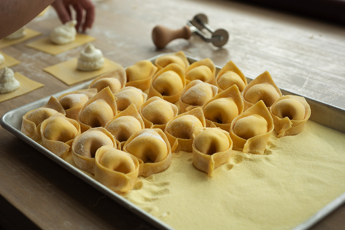 The finished tortelli are set out to dry. At left are squares of dough with the burrata Tortello uses in its signature  dish.
