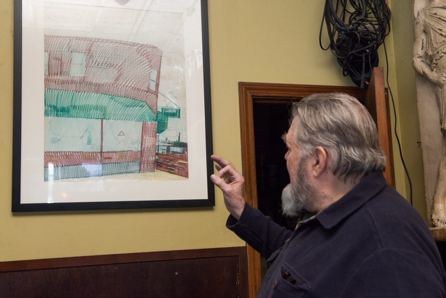 Willis's drawing of Quenchers hangs between the restrooms and the sound booth.