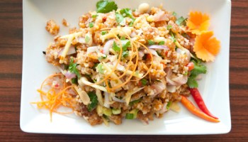 <i>Naem khao tod</i> is a masterful balance of textures—fryer-fused clumps of alternately puffed, crunchy, and soft rice.