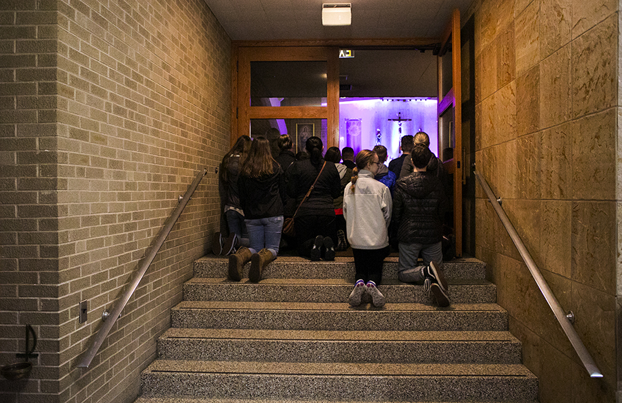 Parishioners overflowed from the nave at Saint Albert The Great Catholic Church.