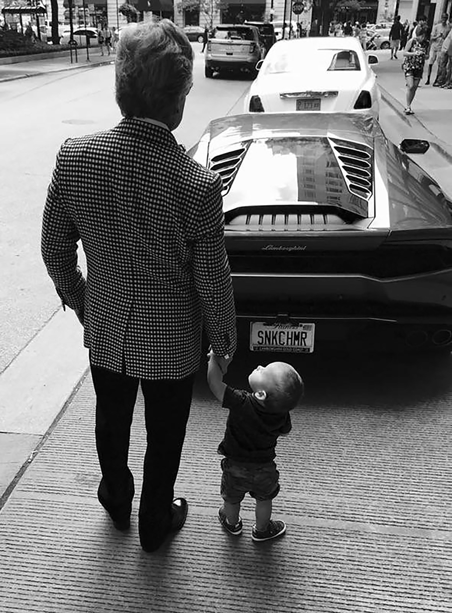 Goldberg with his son, Maximilian, and his Lamborghini in 2016