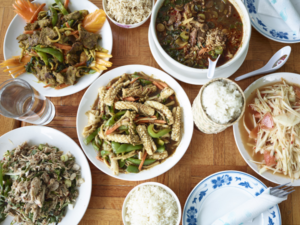 Clockwise from top left: beef pad taming, kow tome (breakfast soup), som tam (papaya salad), pad cha (squid), and the powerfully funky and spicy jackfruit salad.