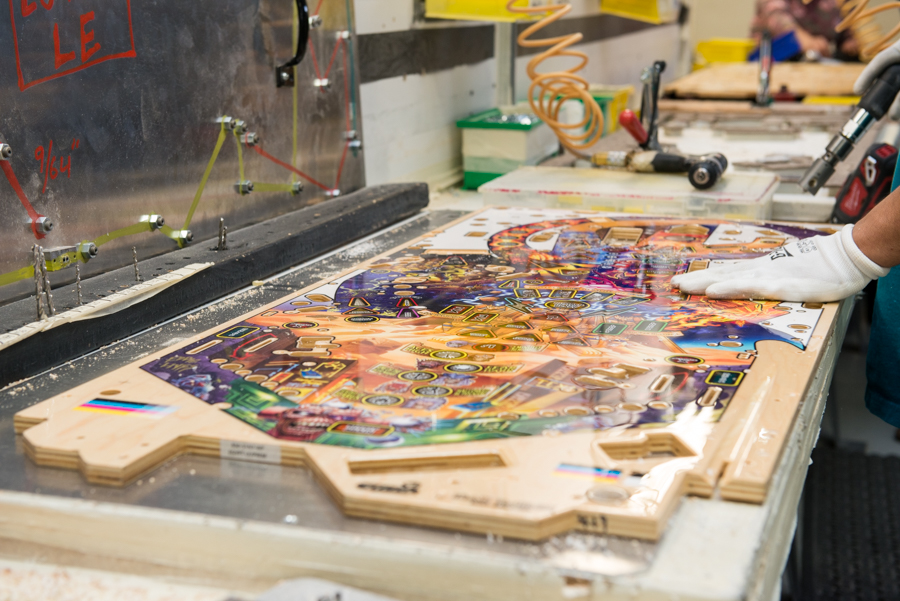 Pinball play fields being built on the assembly line