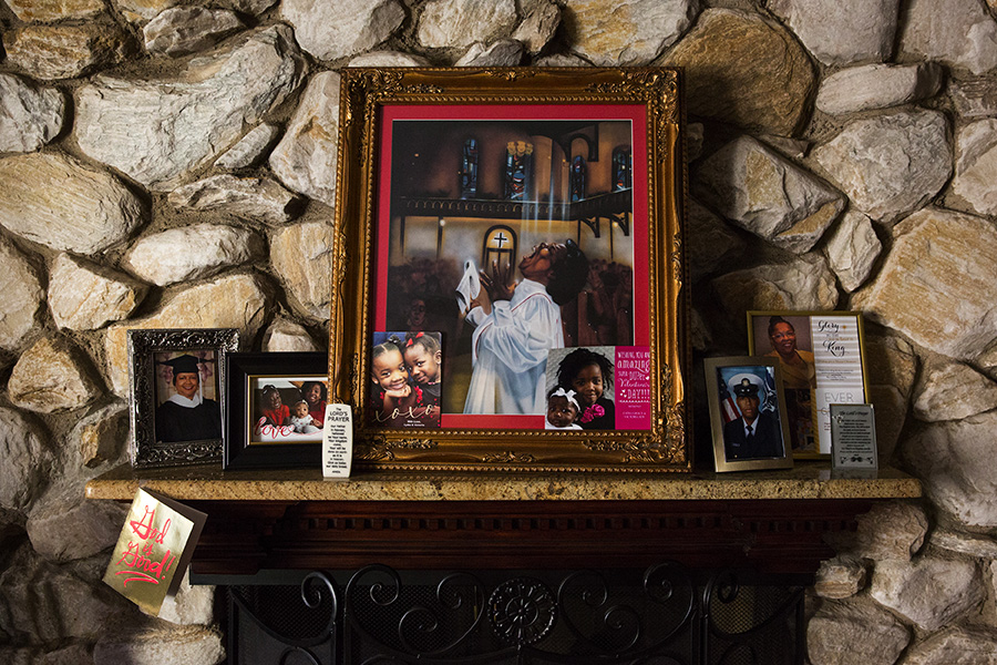A stylized painting of Mama Lou hangs above the fireplace in her living room in southwest-side Wrightwood. Her niece bought it at a garage sale while on vacation in New Orleans 25 years ago.