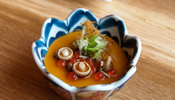 Chilled tofu, as creamy as a custard, embedded with salmon roe and tiny mushrooms