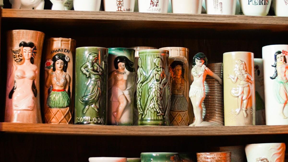 A selection of the Carters' extensive tiki mug collection.