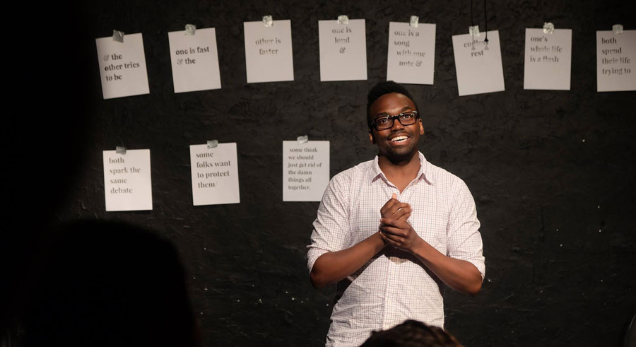Comedian Martin Morrow performs at <i>Take Action Show</i>.