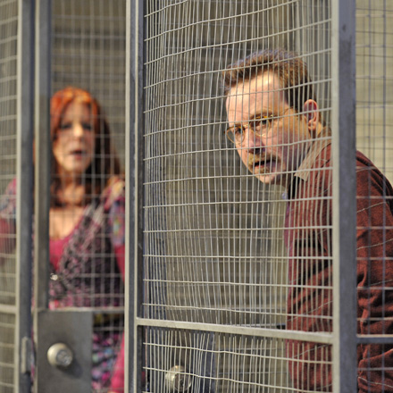 Kate Buddeke and Kevin Stark, caged, in The North Plan at Theater Wit.