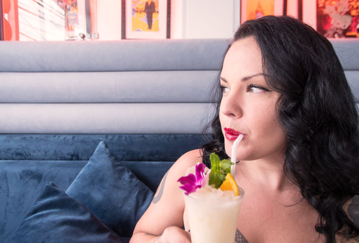 Sagoi drinks her 1,000 Tears of a Tarantula cocktail