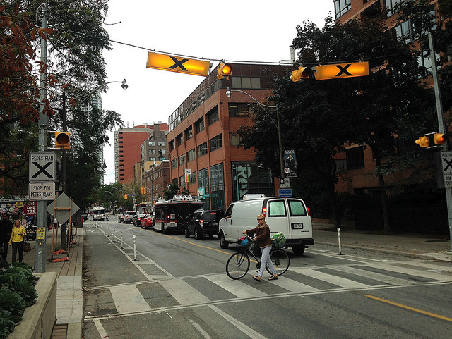 Button-activated beacons make it safer to cross the street mid-block.