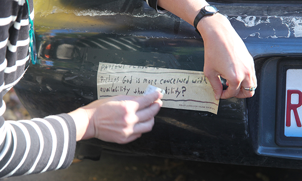 """For October's Trunk Show, artist Kelly Lloyd displayed her bumper sticker that featured a found quote: """"Prehaps God is more concerned with my availability than my ability?"""""""