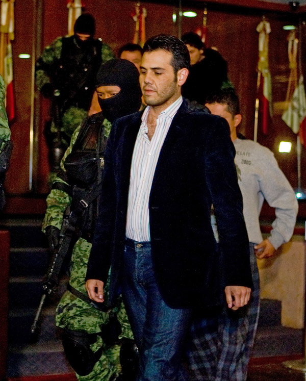High-ranking Sinaloa cartel member Vicente Zambada is taken into custody to be presented to the press at the attorney general's office in Mexico City in March 2009.