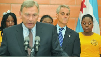 David Vitale, president of the Chicago Board of Education, speaks at a press conference as Mayor Rahm Emanuel looks on. Emanuel and the school district took months to hand over public financial records to the <i>Chicago Tribune</i>.