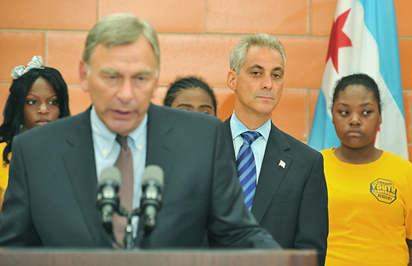 David Vitale, president of the Chicago Board of Education, speaks at a press conference as Mayor Rahm Emanuel looks on. Emanuel and the school district took months to hand over public financial records to the Chicago Tribune.