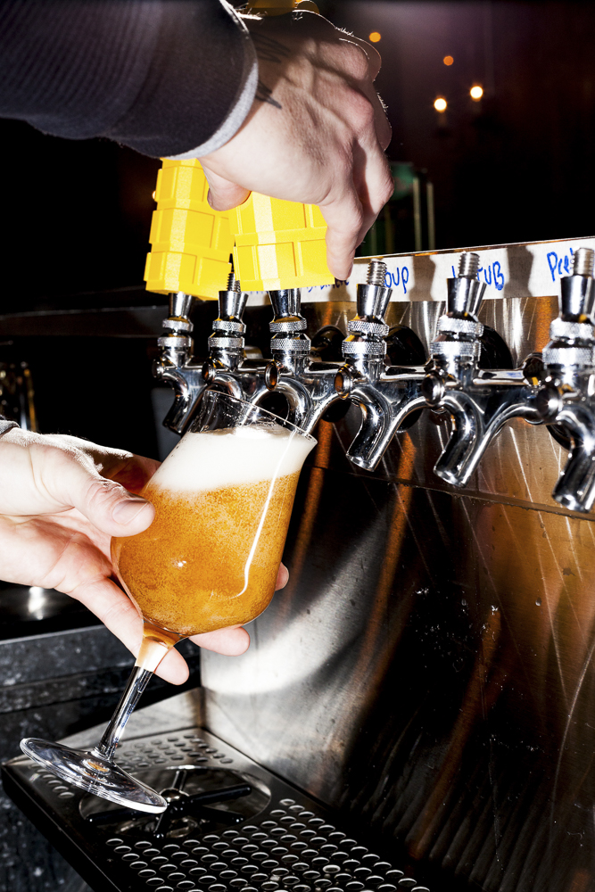 Bright yellow tap handles pour a variety of beer from Whiner.