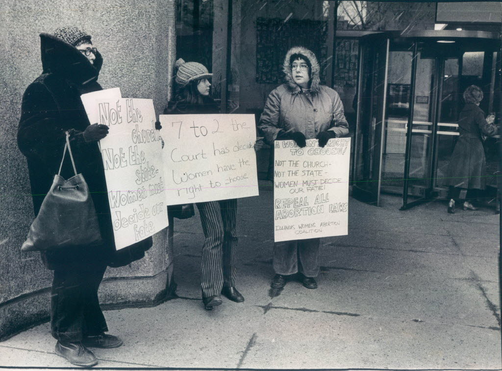 Three representatives of the Illinois Women's Abortion Coalition picket in favor of <i>Roe v. Wade</i> in January, 1973.