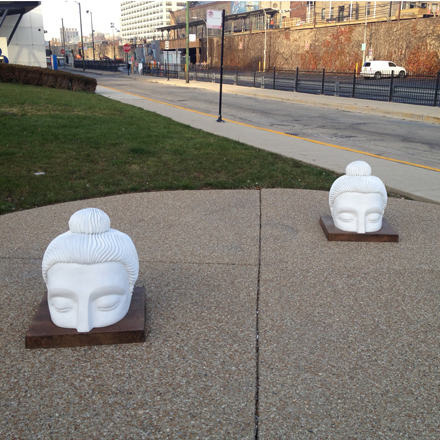 Be sure not to trip over Indira Johnson's half-submerged Buddha heads when you're in Uptown.