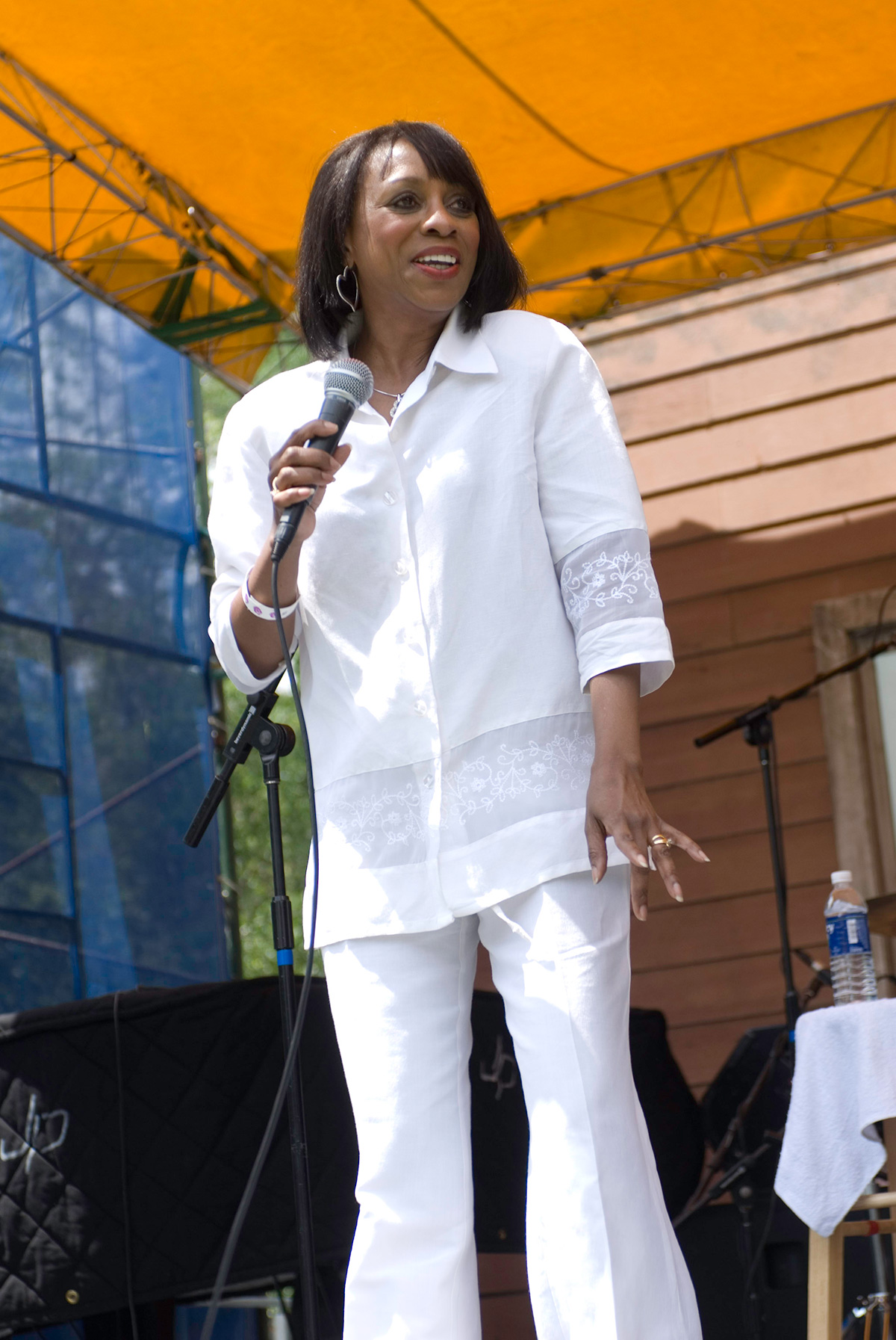 """blues singer Melvia """"Chick"""" Rodgers on stage wearing a white suit"""