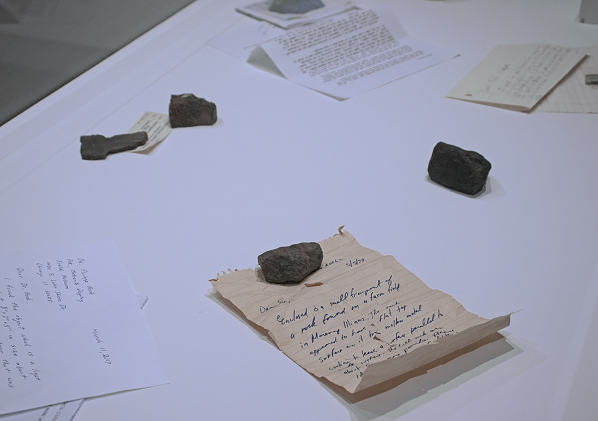 an installation of rocks and letters at the Earthly Observatory exhibition