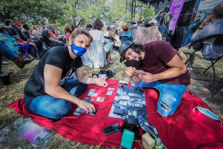 Mislav Forrester and Jorge Avila play Magic: The Gathering at the Hyde Park Jazz Festival.