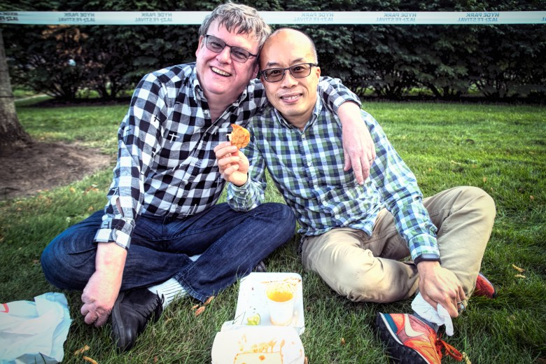 Fans Olaf Wiest and Andy Yau enjoy some Harold's Chicken at the Hyde Park Jazz Festival.