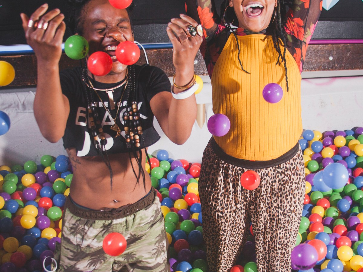 Nick Alter and Rae Chardonnay, cofounders of the nightlife events organization Party Noire, surrounded by play balls