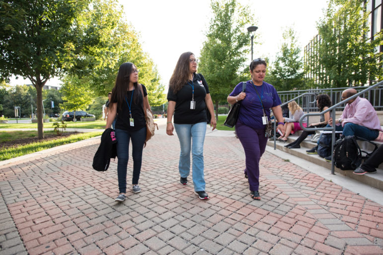 Jaqueline Espinal (left) walks into Truman College with her classmates Beatriz Morales (center) and Marivel Rivera.