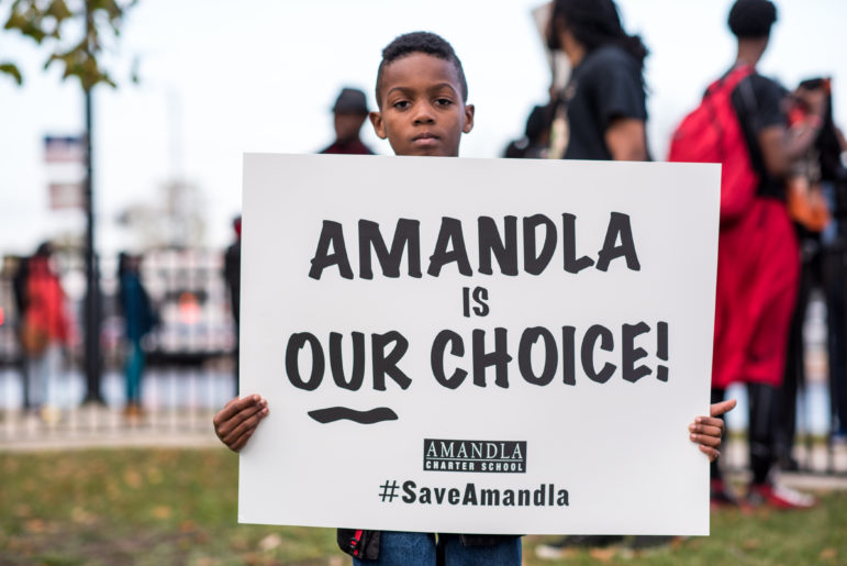 Amandla Charter School students rally outside a roller skating rink in Englewood on Nov. 11, 2015 to protest a CPS recommendation to close the school for poor performance.