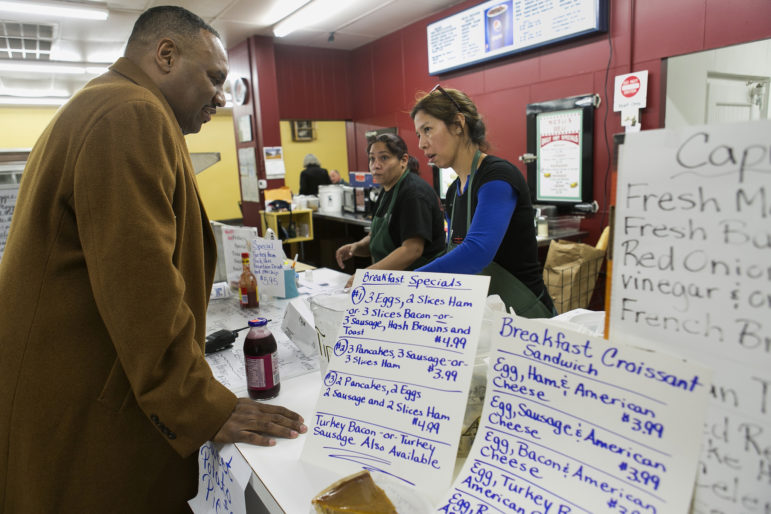 Dana Butler picks up lunches, including his chicken salad sandwich, from Stacee Tolbert (cq) and Irene Hogue at Miceli's Deli & Food Mart.