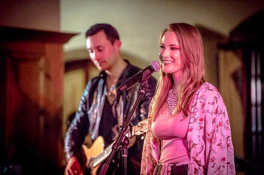 Maggie Fewkes, seen here performing with Ryan Quinn at the Jeffery Pride Foundation Fundraiser at the Onion Pub in Barrington, was selected as one of 90 high school students to attend a special music summer camp hosted by the Grammy Museum in Los Angeles.