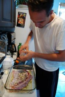 Nathan preparing his Moretaria et Agnina (Mint, coriander, fennel, pepper, celery seed sauce with lamb ribs from the Logan Square Farmer's Market)
