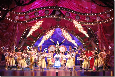 """Emily Behny as Belle, and the cast of Disney's """"Beauty and the Beast"""" in the number """"Be Our Guest"""". Photo by Joan Marcus"""