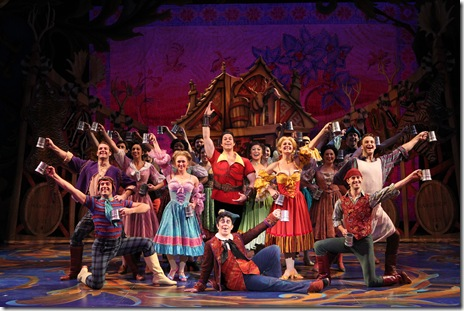 """Logan Denninghoff as Gaston, Andrew Kruep as Lefou, and the villagers in Disney's """"Beauty and the Beast"""". Photo by Joan Marcus"""