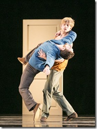 Hubbard Street Dancers Jesse Bechard (in blue) and David Schultz in Casi-Casa by Mats Ek. (photo credit: Todd Rosenberg)
