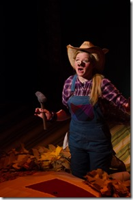 "Mary Margaret Roberts stars as Siu in Emerald City Theatre's ""The Three Little Pigs"" by George Stiles and Anthony Drewe, directed by Ernie Nolan. (photo credit: Tom McGrath)"
