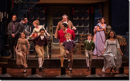 """Kareem Bandealy, Amaris Sanchez, Phillip Cusic, J. Salome Martinez, Nathaniel Buescher, Aaron Lamm and Skye Sparks star in Goodman Theatre's """"A Christmas Carol"""" by Charles Dickens, adapted by Tom Creamer, directed by Henry Wishcamper. (photo credit: Liz Lauren)"""