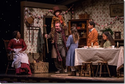"""Penelope Walker, Ron Rains, Nathaniel Buescher, Amaris Sanchez, Philip Cusic and Skye Sparks in Goodman Theatre's """"A Christmas Carol"""" by Charles Dickens, adapted by Tom Creamer, directed by Henry Wishcamper. (photo credit: Liz Lauren)"""