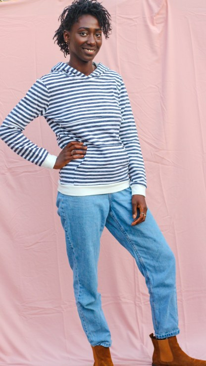 Women models a striped navy and white breastfeeding hoodie jumper.